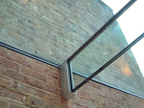 it's all in the details: laminated glass beam in stainless steel shoe supporting glass roof