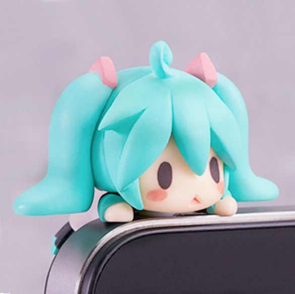 Give your phone some bling of kawaii with a heart-melting Hatsune Miku phone plug.