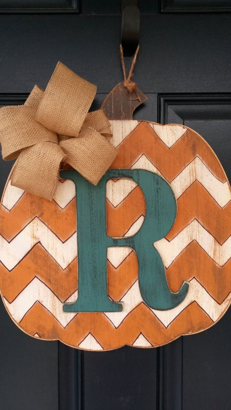 Fall door decor, Wood pumpkin door decor with intital, Fall door decor with monogram, Front door decor by BlessHerHeartDesigns on Etsy - minus the chevron and just a painted pumppkin