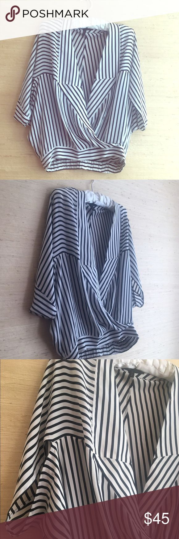 BCBG MazAzria silk blouse Black and white flowing silk BCBG MaxAzria blouse.  Worn once.  Looks great with black leggings and heels or boots.  Size S.  Dry Clean Only. BCBGMaxAzria Tops Blouses