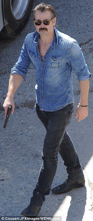 Locked and loaded: Colin also was involved in the gun battle filmed for the show's upcoming second season