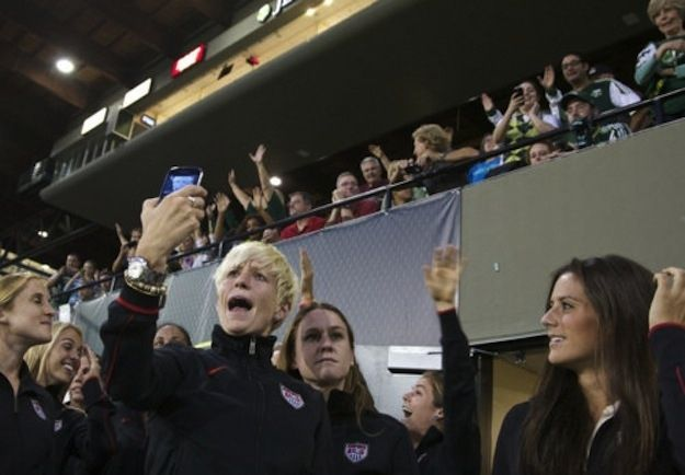 …probably by taking selfies on your phone. | 19 Reasons Megan Rapinoe Would Make The Ultimate BFF