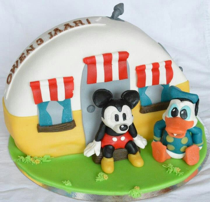 Mickey and donald in front of there trailer. Cake filled with swiscream