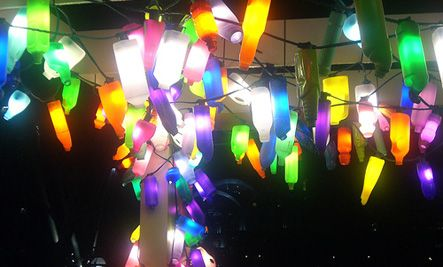Plastic bottle hanging lights. I might do this around our outdoor bar this summer! What a cool, easy idea!