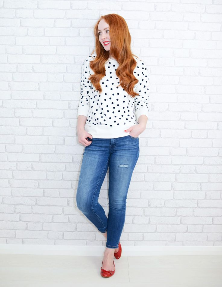 polka dot sweatshirt with blue jeans and red flats