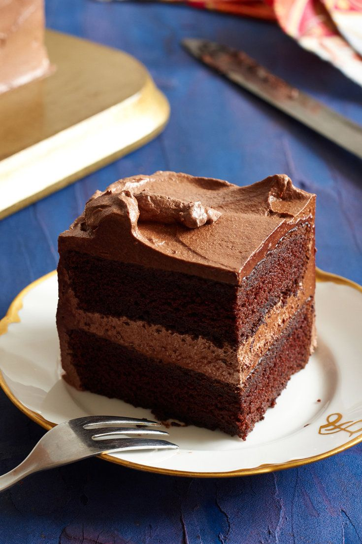 "NYT Cooking: In her new book, ""My Kitchen Year: 136 Recipes That Saved My Life,"" Ruth Reichl calls this the cake that cures everything. The recipe produces a large stacked rectangular layer cake with whipped cream cheese in the frosting to add lightness and stability. The cake is very tender, based on a technique she first started using when she was a cook at the Swallow, a res..."