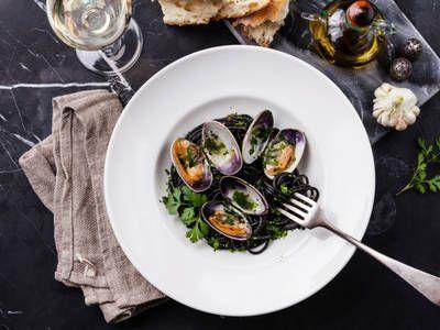 Garlic Parsley Clams With Squid Ink Spaghetti
