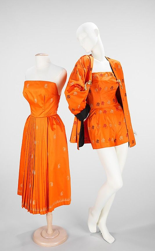 "Orange cotton brocade beachwear (bathing suit, robe, and sundress), by Carolyn Schnurer, American, 1950. This coordinates set from the ""Flight to India"" collection was inspired by the Moghul influence on Indian dress apparent in the metallic embroidery of the fabric as well as the cut of the coat. Inspiration from the pleating of the sari is also in evidence in the skirt of the dress."
