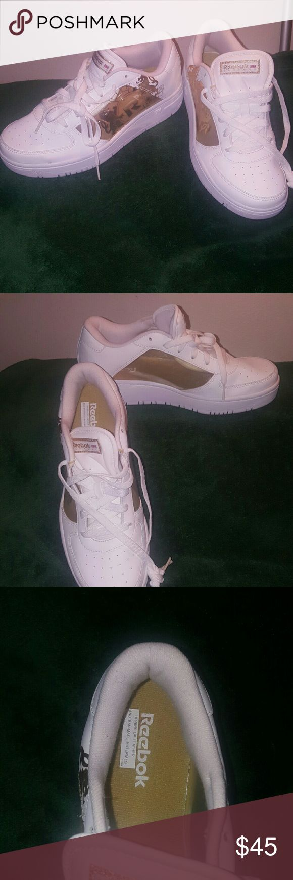 White & Gold Reebok Classic New never wore it was a gift but wrong size.  Clear on the sides. Reebok Shoes Sneakers
