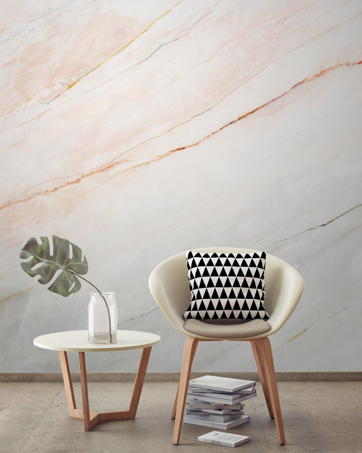 Blush pink and marble work so well together. This textured wallpaper design brings both of these elements together to give you an ultramodern look. Ideal for design-forward living room spaces looking for a touch of luxury.