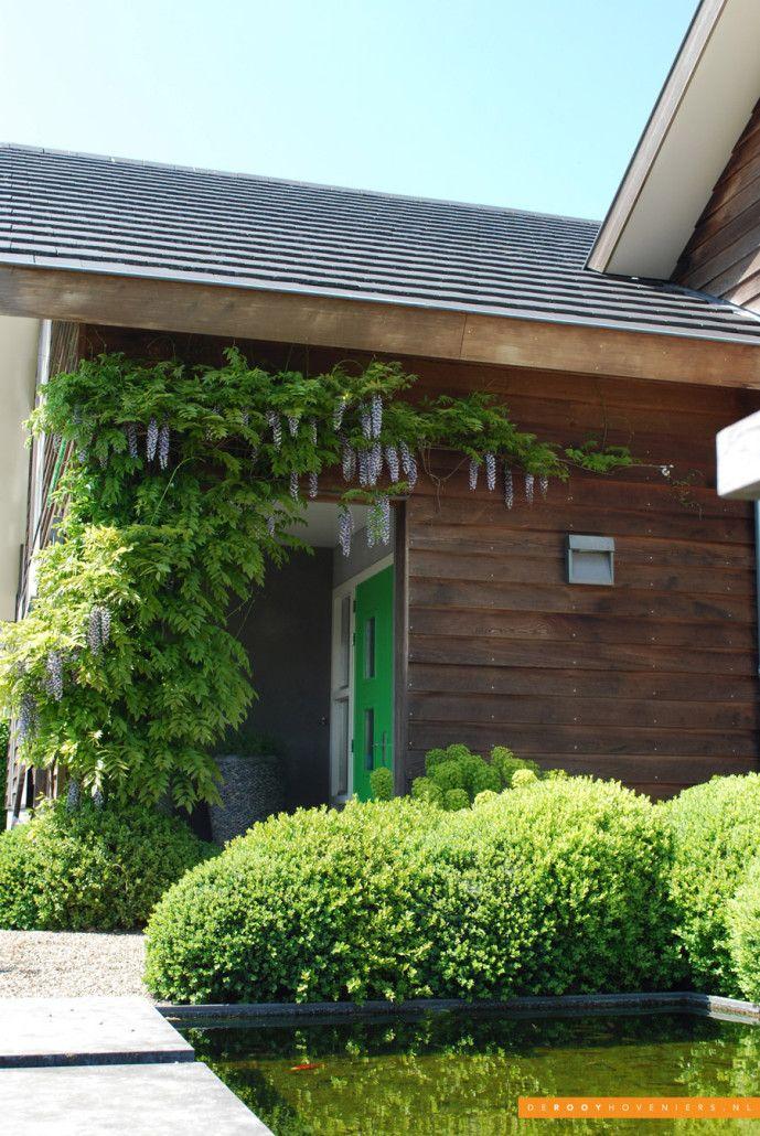 Tuin ideeën De Rooy Hoveniers bedrijfstuin vijver buxusbollen Dussen