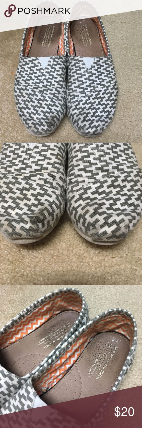 Toms canvas slip ons Gray and white chevron. Worn (some wear on toes but could be washed) but no damage/holes to fabric. Toms Shoes
