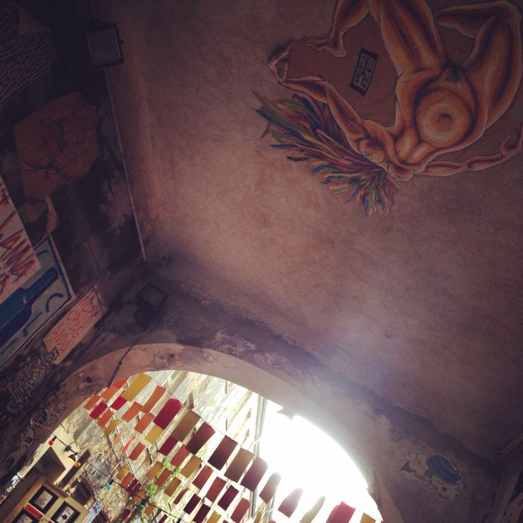 Berlin baby rock it up -AC lady on ceiling amazing art