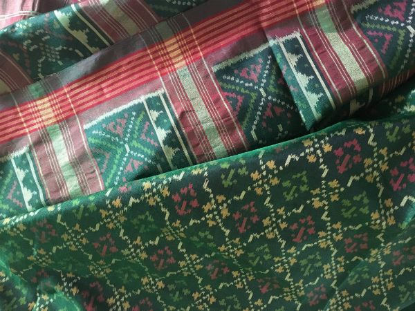 Green and Red ikat Saree   http://writersbrew.com/2017/02/patola-dreams-sarees-tell-stories/