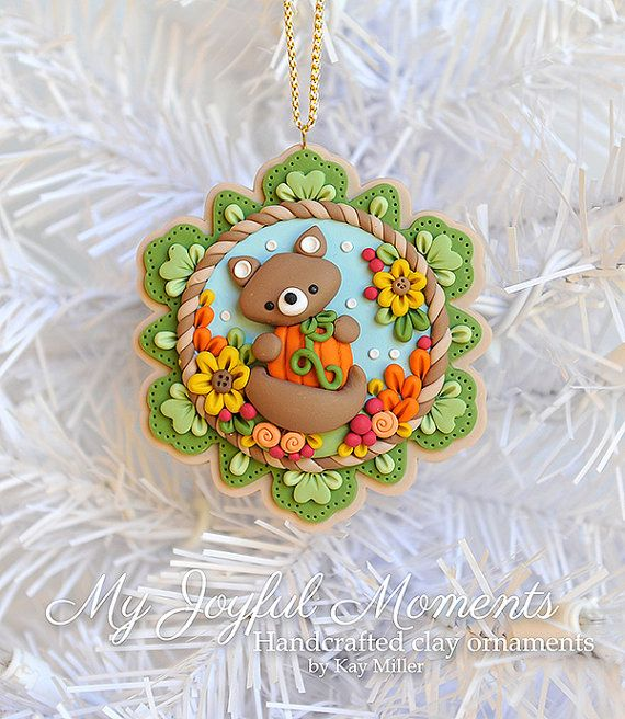 This is s one of a kind, handcrafted ornament made of durable polymer clay, with much attention given to detail and careful construction. No molds have been used, so you can be sure you are receiving a unique and one of a kind keepsake. This ornaments measures approximately 3 1/4 inches wide by 3 1/4 inches tall not including the ribbon hanger. The item in the photo is the exact item you are purchasing and will receive, as I do not like to create the same thing twice :) This beautiful p...