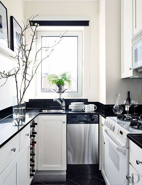 This galley kitchen was updated with a black-and-white palette   archdigest.