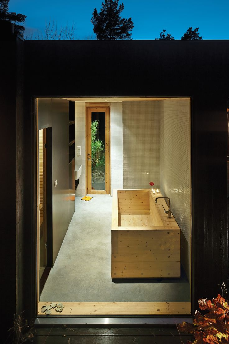 Sævik designed the wood tub in the bathroom, which features an adjacent sauna. The Inxx A5 faucet is by Mora.  Photo by Ivan Brodey.