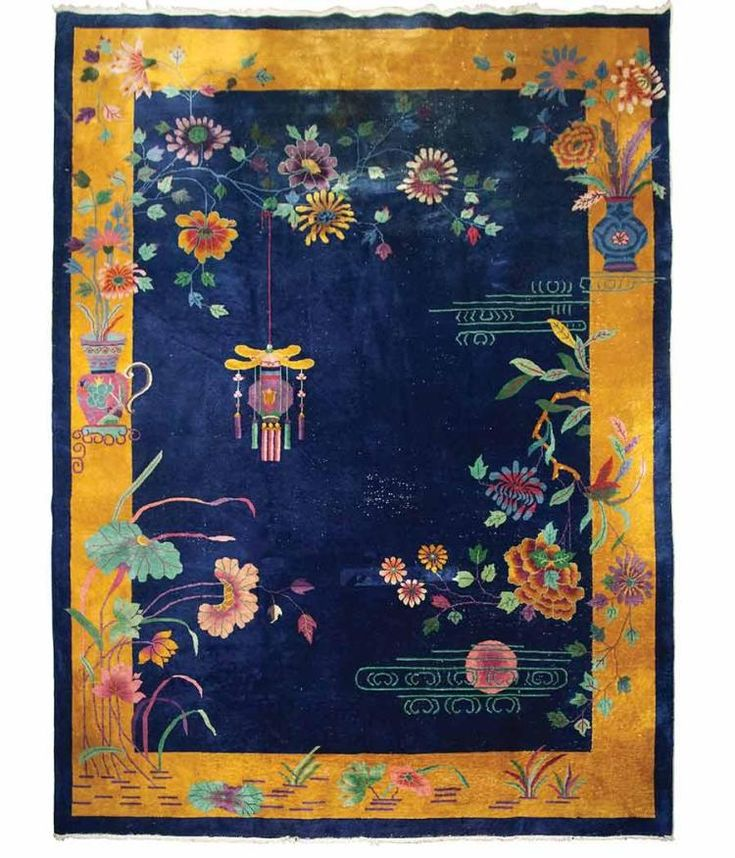 Art Deco Chinese Carpet  Estimate: $400 - $600 Description: Art Deco Chinese Carpet China, circa1925 The midnight blue field sparsely ornamented with polychrome flora is within a gold border. Approximately 11 feet 8 inches x 9 feet. Areas of wear C The Collection of Willa Kim and William Pène du Bois