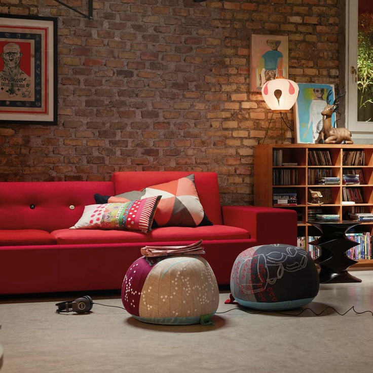 Exposed brick and Moroccan cushion poufs - YES