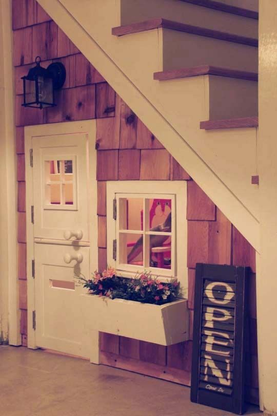 under stair play house, cool idea, however photo looks to me to be a doll house.