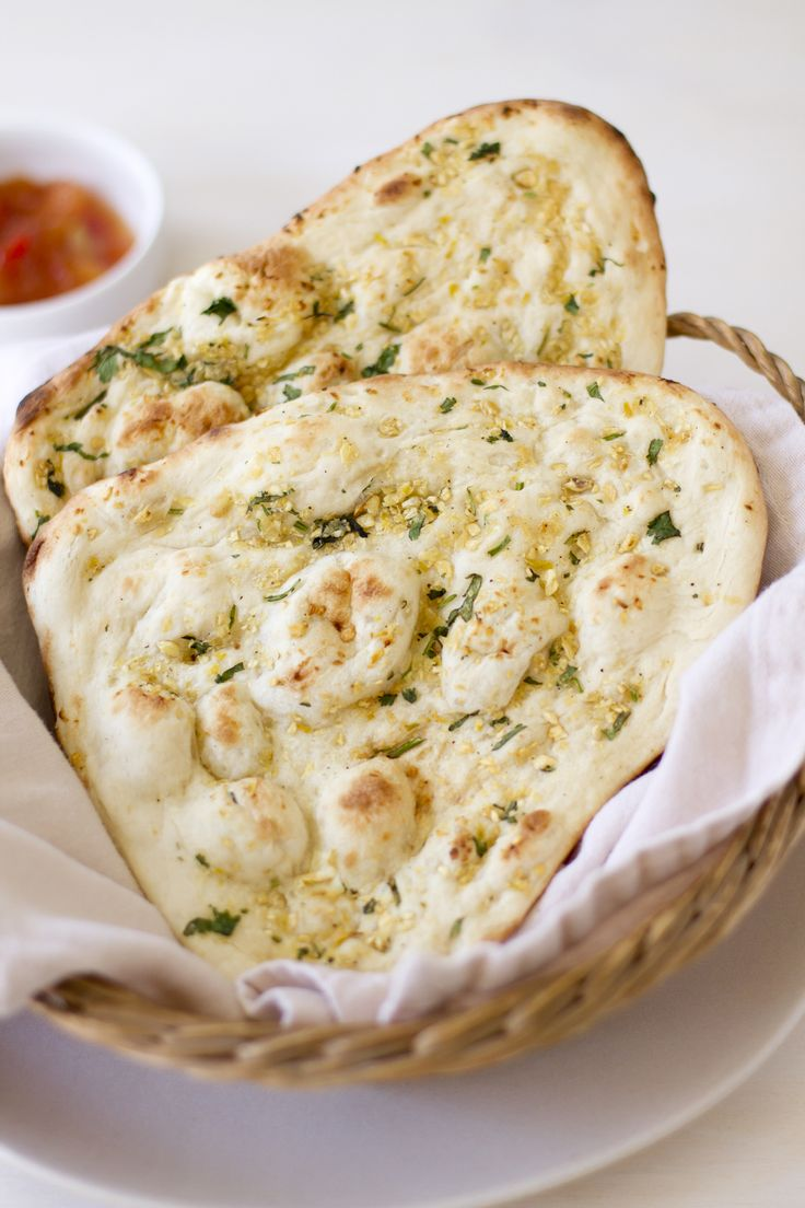 Garlic Naan - * 1 package active dry yeast, * 1 cup warm water, * ¼ cup white sugar, * 3 tbs. milk, * 1 egg, beaten, * 2 tsp. salt, * 4½ cups bread flour, * 1 tbs. garlic minced, * ⅓ cup butter melted. Click for Recipe