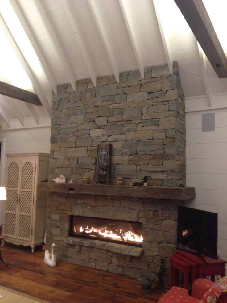 Rustic dry stacked muskoka granite. Completed with custom floating hearth and oversized key stone. By: Adam Saunders