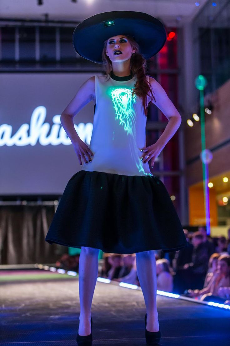 Illuminated video dress powered by projections.