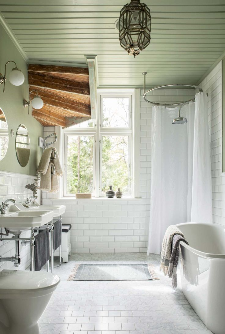 Bathroom with pastel green walls and ceiling