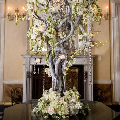 """JJ WED designed a shimmering serving station with dozens of glass-blown baubles hanging from flocked birch branches, as well as tall floral """"trees"""" that framed a lovely monogram ice sculpture. Description from pinterest.com. I searched for this on bing.com/images"""