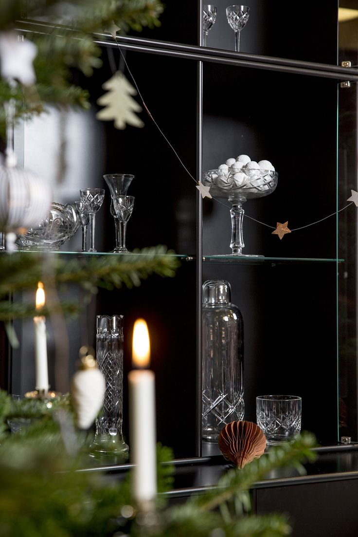 Christmas is all about inviting guest home. RISE is the tall display cabinet that will show off your fine tableware and chrystal glasses. #montana #furniture #storage #cabinet #vitrine #display #danish #design