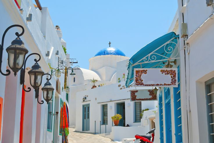 Colorful view on the island Chora village, white temple with blue dome