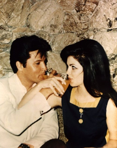 Elvis / Priscilla. Drinking. And showing love.