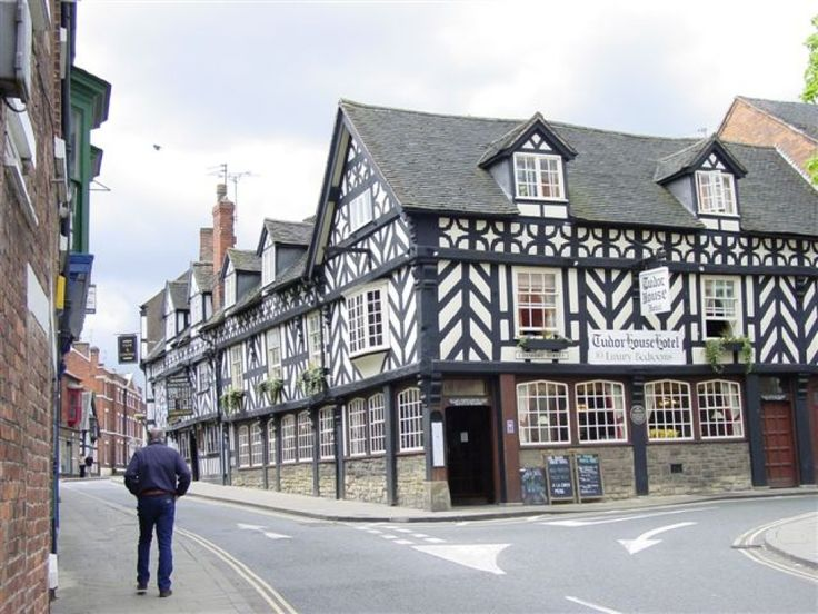 Market Drayton is famous as the home of Gingerbread, and as the birthplace of Robert Clive - Clive of India, he was educated at the Grammar School, founded in 1558, and his desk bearing his carved initials is still preserved.Photo of This is the Tudor House Inn in Market Drayton, Shropshire., by Jan Borgman - Pictures of England Royalty Free Stock Photos