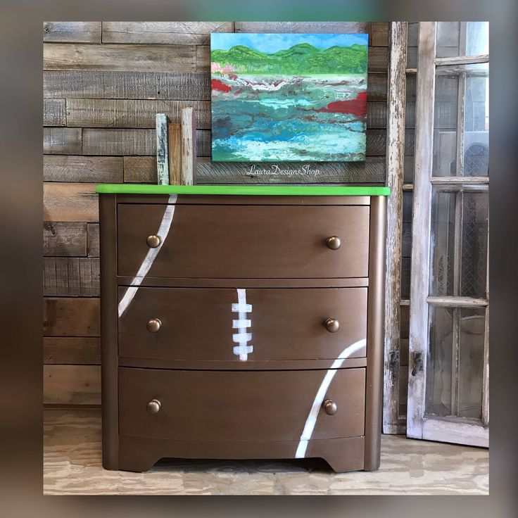 A personal favorite from my Etsy shop https://www.etsy.com/listing /531707346/football-dresser  I painted this small dresser in a football brown color-lightly distressed it so it looks like a worn vintage football dresser.  Three pull out drawers manufactured lining of newspaper painted the top green to look like a football field.
