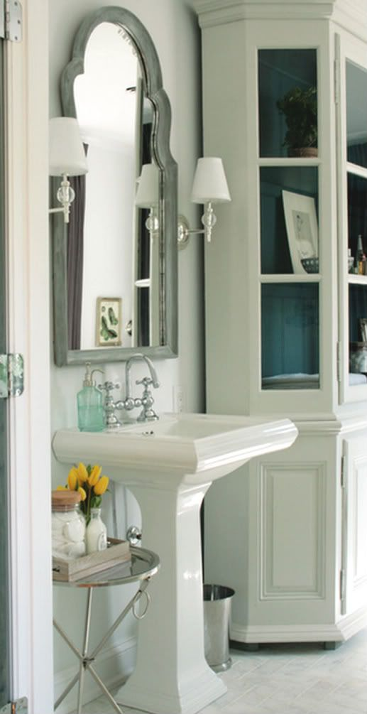 Love the white on white and then the punch of blue in this bathroom