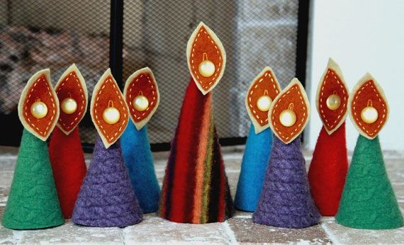 A felt menorah (even kids can light it because there's no actual fire): | 27 Awesome And Unexpected Menorahs - no longer available on Etsy, but I think I could make one.