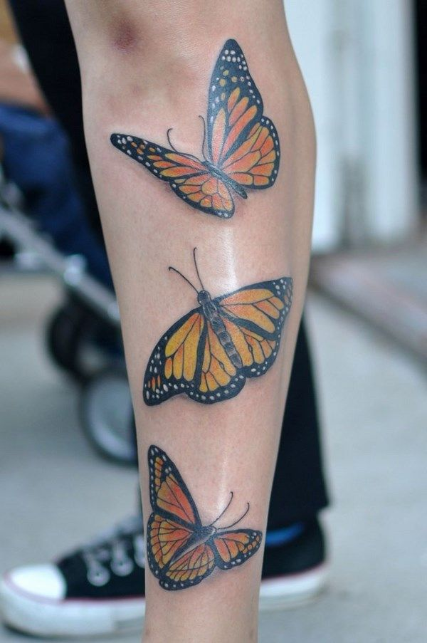 yellow butterfly leg tattoo