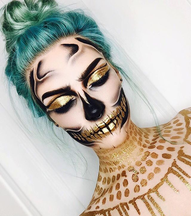 """October 2nd! ✨ I used:  @sugarpill """"goldilux"""" pigment mixed with @litcosmetics adhesive glue for all the gold! (Obsessed with thissssssss, I felt like I was pouring liquid gold on myself) @maccosmetics """"black black"""" chromaline  @meltcosmetics """"dark matter"""" & """"assimilate"""" shadow  Hair coloured by @paulkpaterson @ishisalon  I'll have a bit on my story later that I recorded when I did this :) #erikamariemua"""