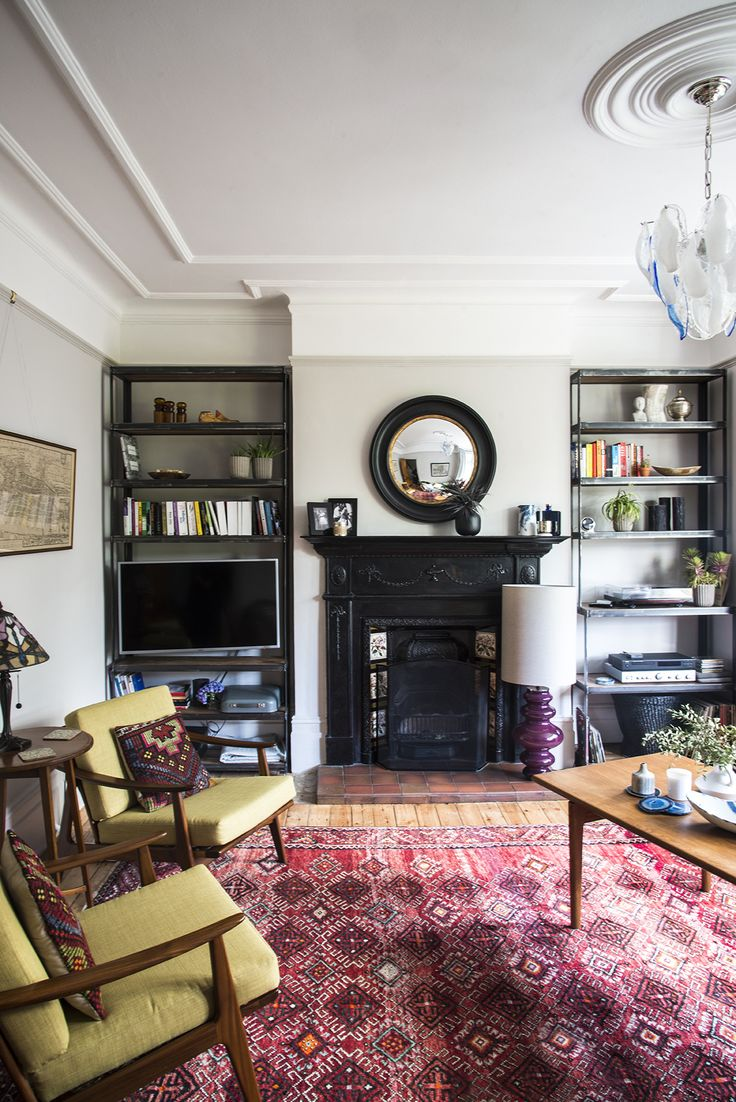 Eclectic living room - Persian rug, industrial shelves, mid-century  furniture and tiffany