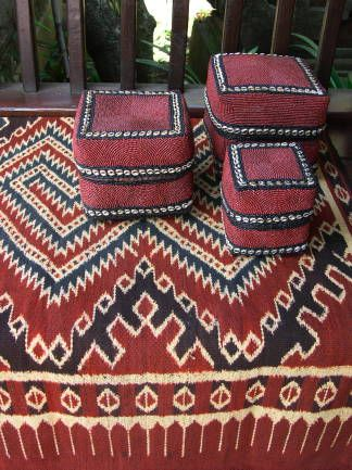 Beaded wedding baskets from Sumatra on a piece of Indonesian Ikat fabric.