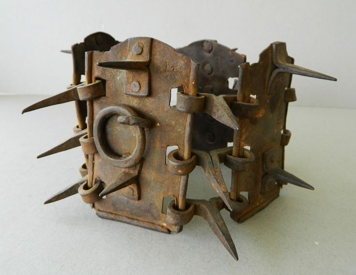 Antique iron spiked dog collar has protective spikes to prevent the wearer's throat from attack by wolves and other wild animals while hunting or guarding flocks. The collar dates from late 17C to early 18C.