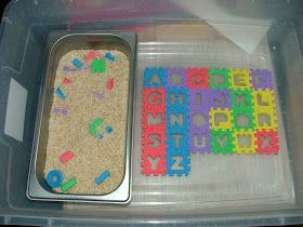 Alphabet fun ; I would put the letters in sand, or just mixed on the table