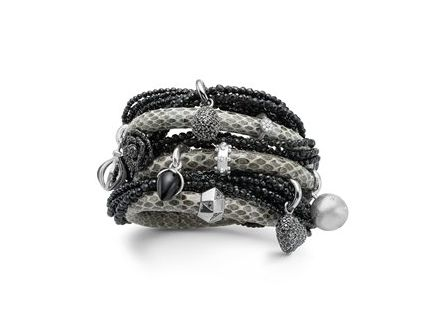 Bracelet made out of snakeskin and the charms is made with silver and black silver.