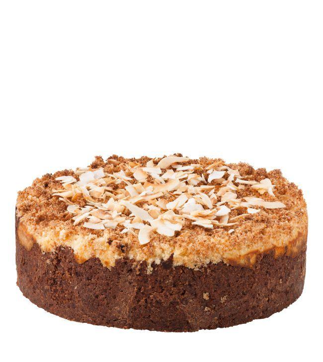 Čokoládovo - kokosový cheesecake V čokoládovo-kokosovém korpusu z máslových sušenek se snoubí chuť sýru Philadelphia a 55% belgické čokolády. Na povrchu je dort posypán lákavou kokosovou drobenkou.