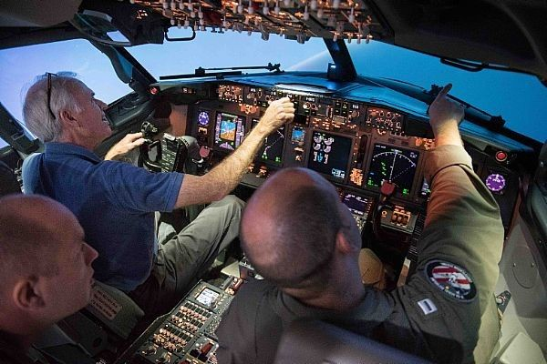 Secretary of the Navy Richard V. Spencer pilots a flight simulator of a P-8A Poseidon aircraft at Naval Air Station Jacksonville, Fla. Spencer is in the area to meet with Sailors and Marines to hear their feedback on the future of the Navy and Marine Corps. U.S. Navy photo by Mass Communication Specialist 1st Class Armando Gonzales