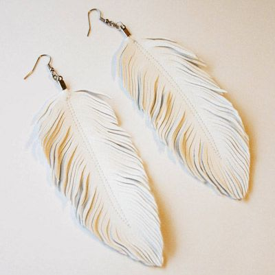 I will own this pair of earrings- leather crafted to look like feathers... and also a pair that are pink dipped in gold sparkles.