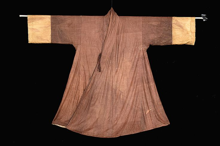 """A jangot (장옷) is a jacket-shaped veil used by women. According to the CHA, it """"has a mulberry-paper lining between the inner and outer layers.... The inner and outer collars are wide, and no collar strip (dongjeong) was found.... The coat is fastened in the chest with ribbons.... [the] positions of the ribbon-ties... indicate that... the coat was actually worn rather than wrapped around the face like a hood."""" 16/17th century. Important Folklore Material 21-8"""
