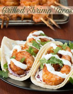 These Shrimp Tacos with Creamy Cilantro Sauce are so delicious! Make them for your next #TacoTuesday!