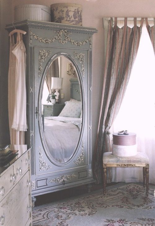 Soft gray antique armoire carving accented with white carvings, mirror... Magnificent!
