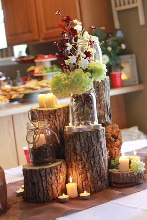 log cluster with pretty things. great centerpiece.